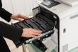 Businesswoman Hand Fixing Copy Machine