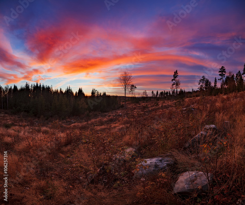 Beautiful vibrant sunset clouds landscape in finland