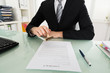 Businessman Stamping On Contract Paper