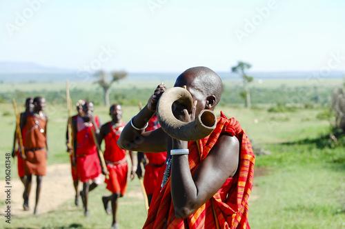 Fotografie, Obraz  Masai Kudu Horn Blowing - Kenya