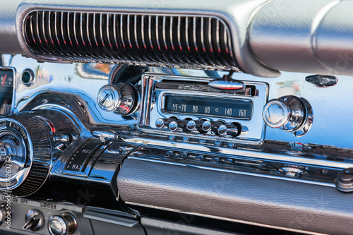 Poster Old cars Car radio into the dashboard which is chromed