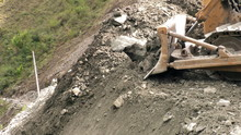Earth Mover Pushing Rocks To T...