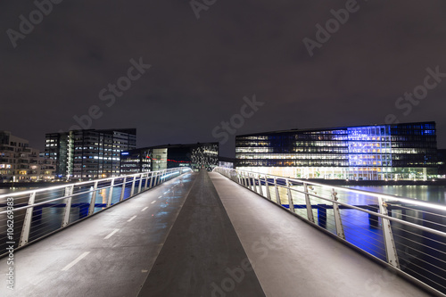 Modern cyclist and pedestrian bridge Bryggybroen in Copenhagen by night Poster