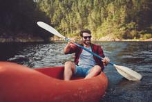 Young Man Kayaking On A Lake