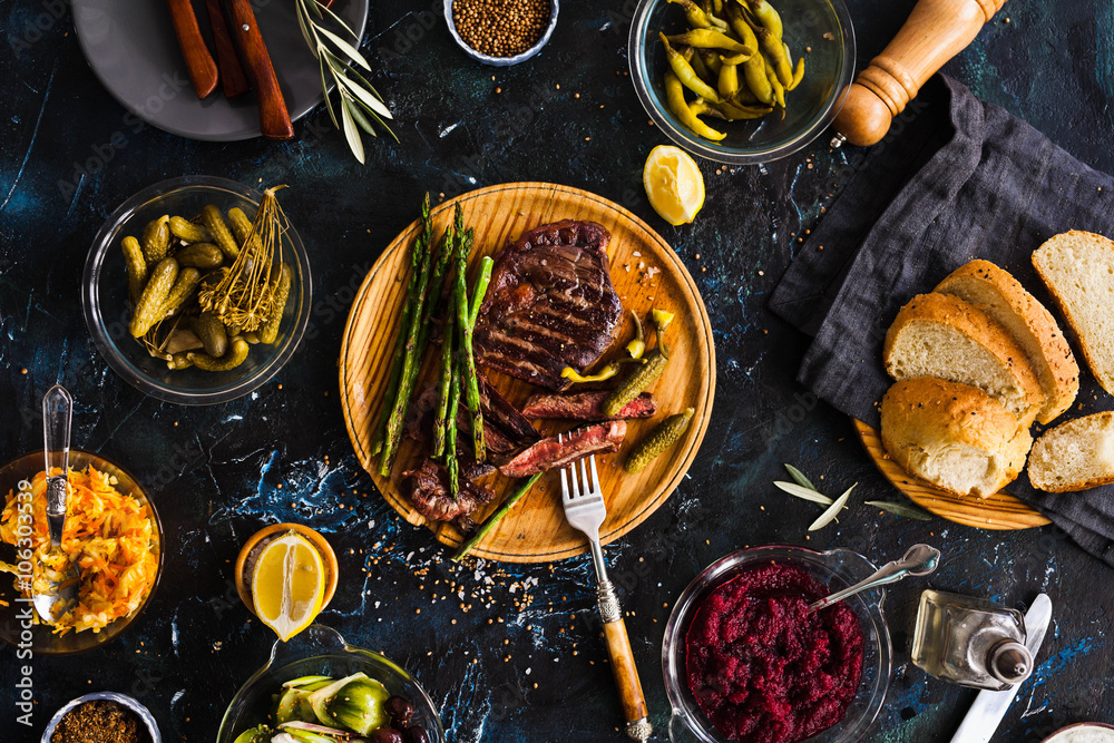 Fototapety, obrazy: BBQ Beef steak with pickled veggies, cucumber, cabbage, beeroot, marinated pepper. Dinner party.