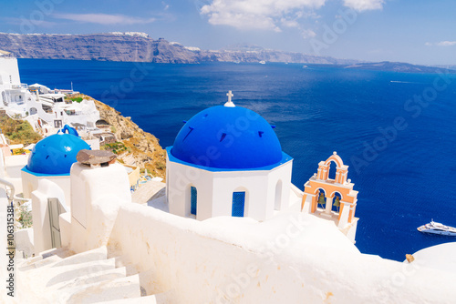 White architecture and blue dome churches in Oia, Santorini, Greece