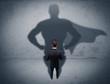 Successful businessman with superhero shadow