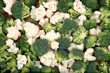 Organic Cauliflower And Broccoli On Wooden Plate