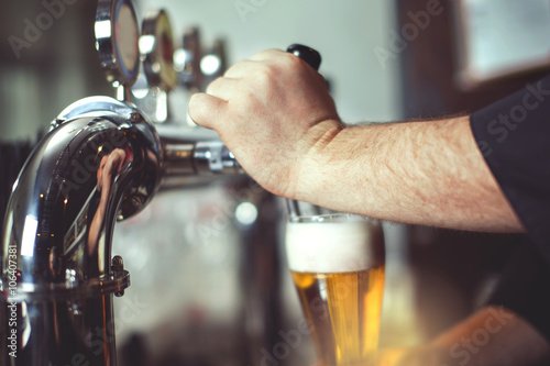 Vászonkép  Pouring fresh beer