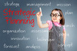 Cute little girl wearing business dress and writing strategic planning concept. Blue background.