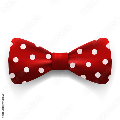 Canvas Print Red polka dot bow tie isolated on white background. Clothing acc