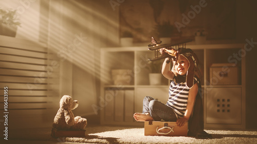 Photo concept of dreams and travels.  pilot aviator child with a toy a