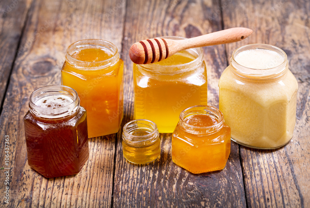 Fototapety, obrazy: various types of honey in glass jars