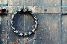 Old Grunge Metal Door With Twisted Steel Door Handle. Vintage Background