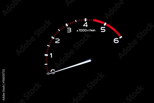 Photo  driver's cockpit ; tachometer on dashboard - white light in black and copy space