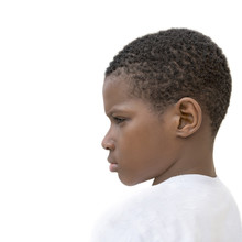 Portrait Of A Moody Ten-year-old Boy, Side View, Isolated