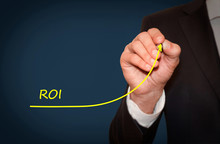 Businessman Draw Growing Line Symbolize Growing ROI (Return On Investment)