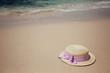 Straw hat on a tropical beach