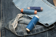 Old Torn Jeans On A Background...
