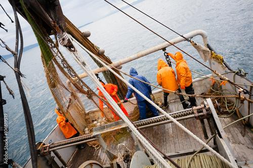 Fotografia, Obraz Fishermen in protective suits on deck Fishing vessel