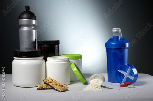 Fotografie, Obraz  Sport Nutrition Supplement containers with shaker