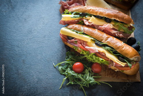 Staande foto Snack Juicy submarine sandwiches
