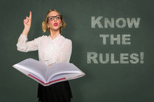 Teacher Holds Rule Book Know T...