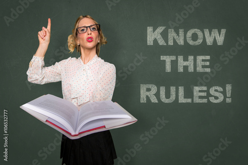 Teacher holds rule book know the rules message classroom lecture discipline moti Canvas-taulu