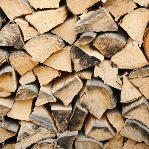 Poster Brandhout textuur Stack of firewood. chopped wood stacked background