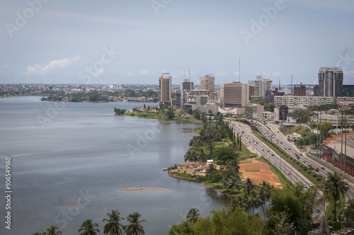 La pose en embrasure Cote Abidjan, the economical capital of Ivory Coast (Cote d'Ivoire), it's business area Plateau with the Atlantic ocean bay in the background. April 2013