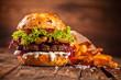 Leinwanddruck Bild - Fresh home-made hamburger served on wood