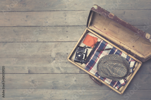 Poster Retro opened vintage suitcases with clothes and accessories. copy spac