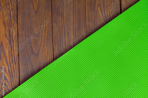 965bbfffe8d59 Detail of perforated green yoga mats on the wooden background. Texture yoga  mats and boards