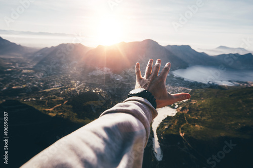 Hand of a man reaching out the beautiful landscape Canvas Print