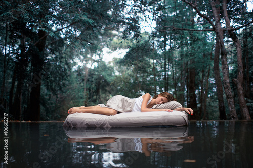 Cadres-photo bureau Spa A hidden place. Sleeping woman in deep forest lies on airbed