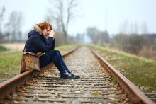 Depression/ Depressed Woman Sitting On A Train Track Seeing No Way Out