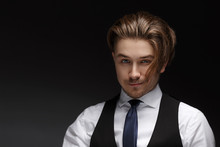Handsome Young Gentelman Wearing Elegant White Shirt  And Black Suit Posing On Camera.