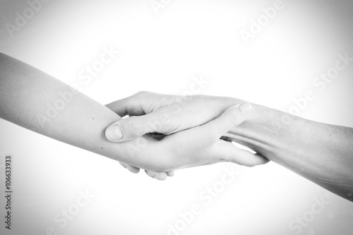 Fotografie, Obraz  Two hands reaching toward each other
