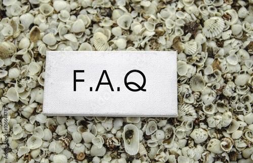 Fényképezés conceptual business motivation image,  word FAQ on white canvas