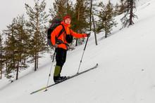 Skier Mountain Hiker Climbs At...