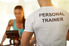 Personal Trainer With Woman On...