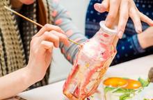Decoupage Bottle. Professional Painter Paints A Souvenir