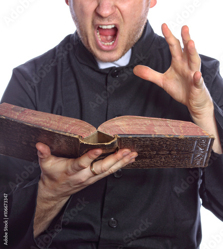Cuadros en Lienzo Exorcism - the priest with bible