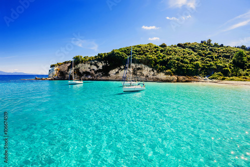 Poster Tropical plage Sailboats in a beautiful bay, Paxos island, Greece