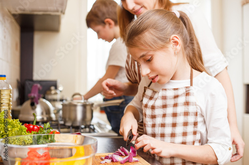 Fotobehang Koken Family cooking. Mum and children in the kitchen