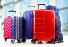 Plastic Travel Suitcases In The Airport Hall