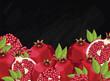 Pomegranate on chalkboard background. Pomegranate composition, plants and leaves. Organic food. Summer fruit. Fruit background for packaging design.