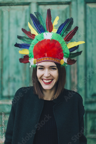 Portrait of woman wearing Indian headdress