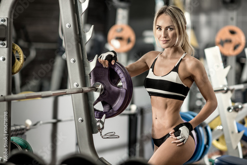 plakat young fitness woman in gym