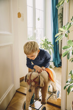 Boy Entering A Room With Old Plush Elephant